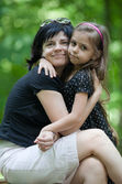 Daughter embracing her mom — Stock Photo