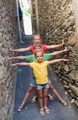 Funny children on narrow street — Stock Photo