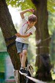 Little boy balancing on a tightrope — Stockfoto
