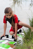 Little girl and windsurfing board — Stock Photo