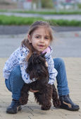 Little girl with her dog — Stock Photo