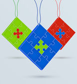 Multi-colored puzzles on a chain — Stock Vector