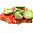 Soy and seed biscuit topped with ham, tomato and cucumber — Stock Photo