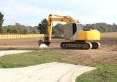 Yellow earth moving machine — Stock Photo