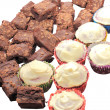 Chocolate brownies and cupcakes — Stock Photo