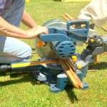 Carpenter using a circular table saw — Stock Photo #27683453