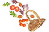 Fruit and vegetables falling from basket — Stock Photo