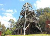 Old wooden Australian coal mining derrick structure — Stock Photo