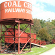 Coal Creek railway siding water tank and train carriages — Stock Photo #39351529