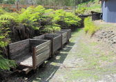 Old historic wooden coal mining carriages — Stock Photo