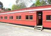 Old red passenger train carriage — Stock Photo