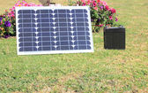 Single solar panel charging a battery — Stock Photo