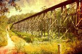 Old railway bridge with weathered vintage retro filter — Stock Photo
