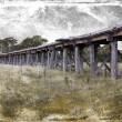 Old wooden Australian railway bridge with grunge textured filter — Stock Photo #51786665