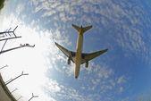 Airplane in fisheye — Stock Photo