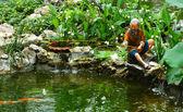 Figurine of man fishing — Stock Photo