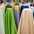 Colorful cotton fabrics on sale — Stock fotografie