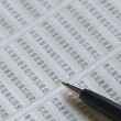 Stock Photo: Ballpoint pen on financial figures