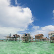 Sea gysies houses on stilts — Stock Photo