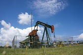 SERIA, BRUNEI-NOV. 3:On shore oil pump (nodding donkey) in Seria — Stock Photo