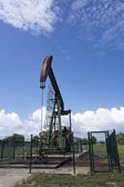Oil pump jack in work. Oil industry in Seria, Brunei Darussalam — Stockfoto