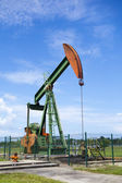 Oil pump jack in work. Oil industry in Seria, Brunei Darussalam — Foto de Stock