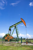 Oil pump jack in work. Oil industry in Seria, Brunei Darussalam — Foto Stock