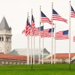 Ring Of Flags WIth The Old Post Office Clock Tower — Stock Photo #23958795