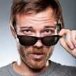 Caucasian Man Looking Over His Sunglasses — Stock Photo #24012377
