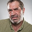 Mature Caucasian Man Looking Grumpy Portrait - Stock Photo