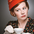 Retro Woman Passing Judgment While Drinking Tea — Stock Photo #24080579