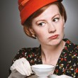 Retro Woman Passing Judgment While Drinking Tea - Stok fotoğraf