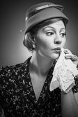 Retro Woman Dabbing Her Mouth With Handkerchief — Stockfoto