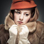 Vintage Woman Clutching Her Faux Fur Coat — Stock Photo