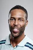 African American Man Sticking Out His Tongue — Stock Photo