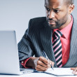 Young African American Businessman Using Laptop — Foto de Stock
