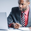 Young African American Businessman Using Laptop — ストック写真