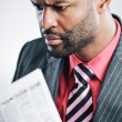 Young African American Businessman Reading Newspaper — Foto de Stock