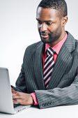 Young African American Businessman Using Laptop — Stock Photo