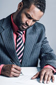 African American Businessman Signing A Contract — Stock Photo
