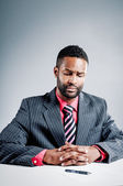 African American Businessman Hesitantly Signing A Contract — Stock Photo