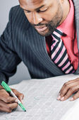Young African American Businessman Reading Classifieds For A Job — Stock Photo