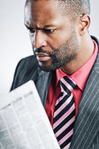 Young African American Businessman Reading Newspaper — Stock Photo