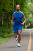 African American Athlete Running On A Wooded Path — Stock Photo