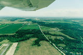 Flying over the countryside — Stock Photo