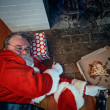 Stock Photo: Drunk and Passed Out Santa Claus