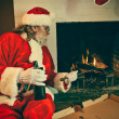 Stock Photo: Bad Santa Reheating Pizza In The Fireplace