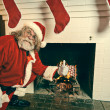 Bad Santa Burning Gifts In The Fireplace — Stock Photo