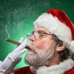 Bad Santa Lighting A Cigar — Stock Photo #24938287