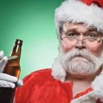 Bad Santa WIth A Beer And Cigar — Stock Photo #24938325